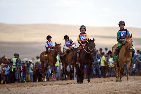 """Purevsurengiin (front L) arriving at the starting line to compete in the """"Inkhnas"""" (over five-year-old horses) horse race.&nb"""
