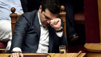 Greek Prime Minister Alexis Tsipras reacts during a parliament session in Athens on July 15, 2015. AFP PHOTO / ARIS MESSINIS        (Photo credit should read ARIS MESSINIS/AFP/Getty Images)