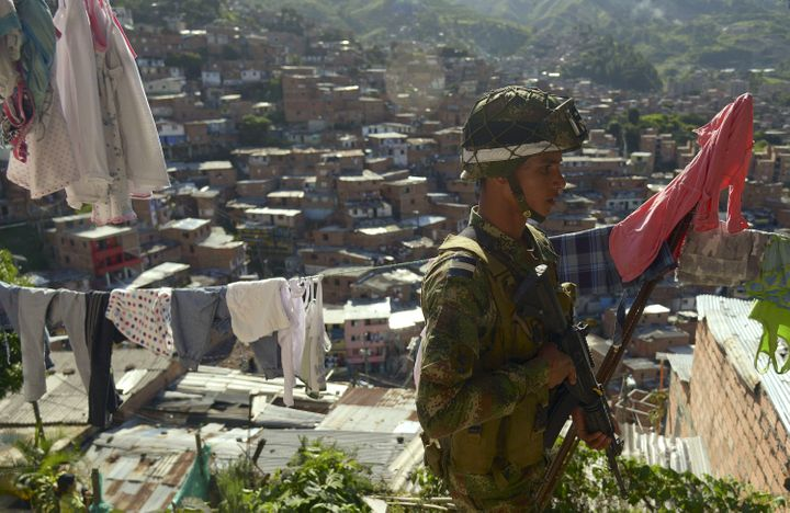 A Colombian soldier patrols the streets at the Comuna 13 shanty town in Medellin, Antioquia department, Colombia on May 24, 2
