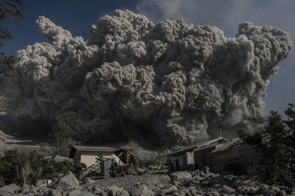 <p>Mount Sinabung volcano spews giant volcanic ash in Karo, North Sumatra on June 25, 2015. Sinabung is one of 129 active volcanoes in Indonesia, which sits on the Pacific Ring of Fire, a belt of seismic activity running around the basin of the Pacific Ocean. AFP PHOTO / SUTANTA ADITYA (Photo credit should read SUTANTA ADITYA/AFP/Getty Images)</p>