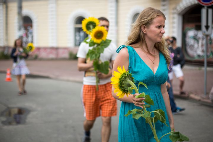 KIEV, UKRAINE - JULY 19:   People bring sunflowers to place in front of the Netherlands Embassy in memory of the victims of M