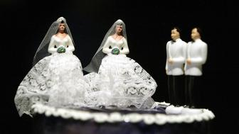 WEST HOLLYWOOD, UNITED STATES:  A wedding cake featuring two grooms and two brides is on display at a local restaurant as part of the preparations for a mass gay wedding in West Hollywood, CA 01 June 2004.  Some one hundred gay and lesbian couples tied nots in a ceremony performed by West Hollywood Mayor John Duran. Although simbolic, the ceremony was organized as part of a campaign organized by Duran and other non profit organizations in an effort to change California laws and allow same sex couples to get marriage licenses.      AFP PHOTO / HECTOR MATA  (Photo credit should read HECTOR MATA/AFP/Getty Images)