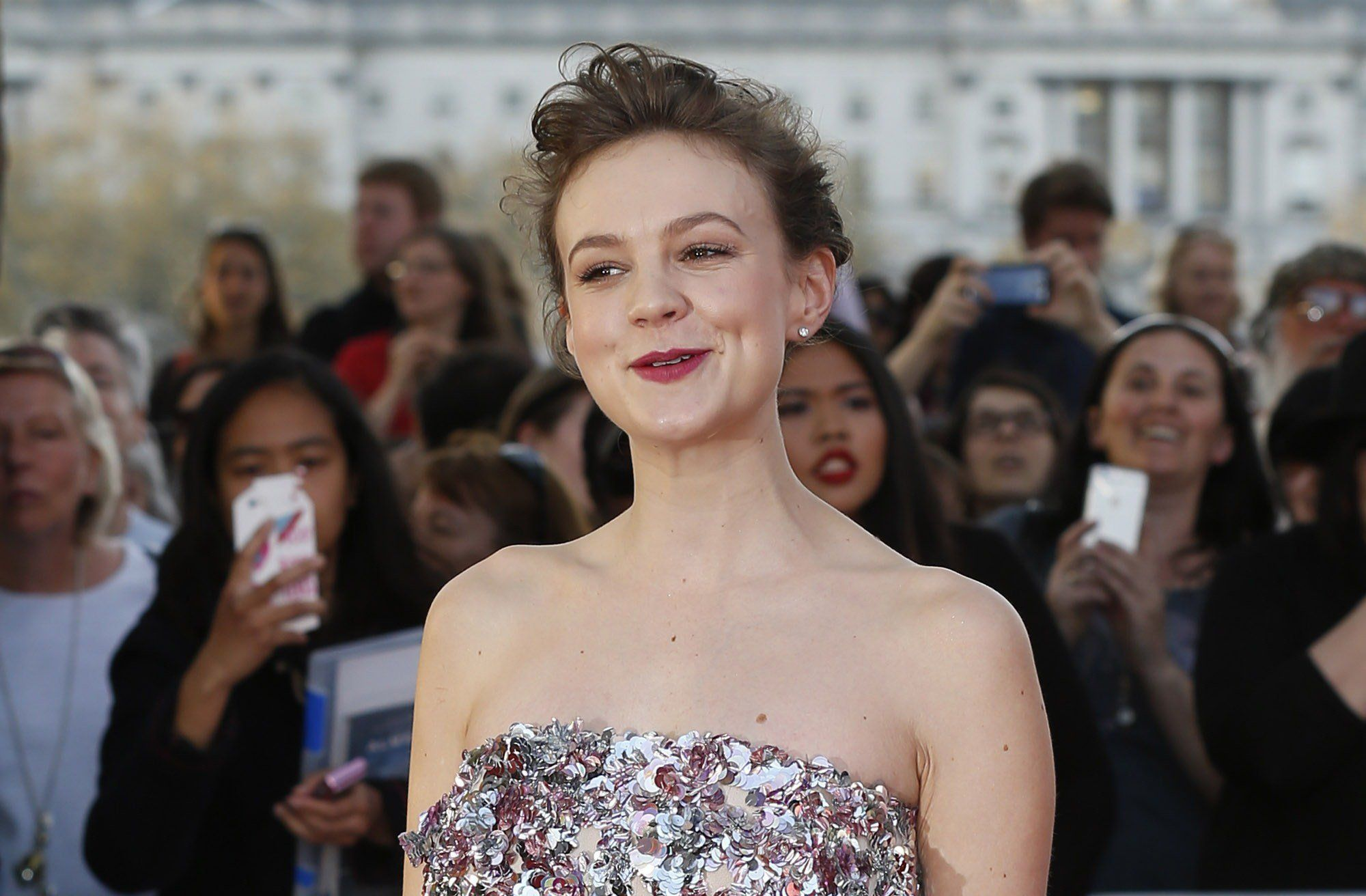 British actress Carey Mulligan poses for photographers on the red carpet on the red carpet ahead of the world premiere of the film 'Far From The Madding Crowd' in central London on April 15, 2015. AFP PHOTO / JUSTIN TALLIS        (Photo credit should read JUSTIN TALLIS/AFP/Getty Images)