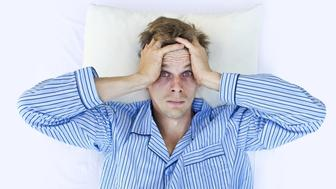 A man not able to get to sleep because of stress