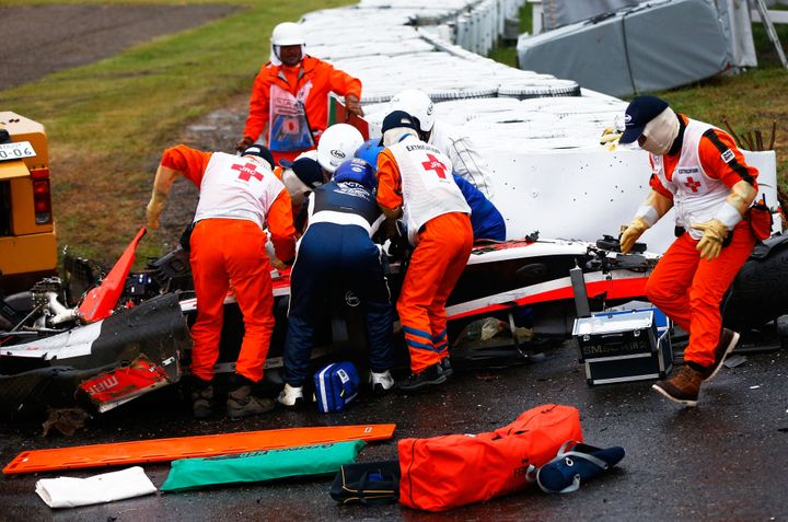 Jules Bianchi of France and Marussia receives urgent medical treatment after crashing during the Japanese Formula One Grand P