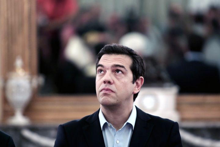 <span>Greek Prime Minister Alexis Tsipras looks up during a swearing-in ceremony of the newly appointed members of the govern