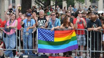 Spectators watch the annual PrideFest parade in St. Louis, Missouri on June 28, 2015. The US Supreme Court made same-sex marriage legal throughout the nation Friday in a much-awaited landmark decision that triggered wild jubilation and tears of joy across the country. AFP PHOTO/ MICHAEL B. THOMAS        (Photo credit should read Michael B. Thomas/AFP/Getty Images)