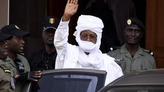 Former Chadian dictator Hissene Habre gestures as he leaves a Dakar courthouse after an identity hearing on June 3, 2015. Habre, who has been in custody in Senegal since his arrest in June 2013, will stand trial in Dakar for torture, war crimes and crimes against humanity from July 20 onwards, the special tribunal set up to judge him said on June 3. AFP PHOTO / SEYLLOU        (Photo credit should read SEYLLOU/AFP/Getty Images)