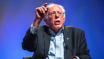 PHOENIX, AZ - JULY 18: U.S. Sen. Bernie Sanders (I-VT) addresses hecklers and supporters at the Netroots Nation 2015 Presidential Town Hall in the Phoenix Convention Center July 18, 2015 in Phoenix, Arizona. The Democratic presidential candidate spoke of income inequality and the flaws of the criminal justice system to nearly 2,000 audience members. (Photo by Charlie Leight/Getty Images)