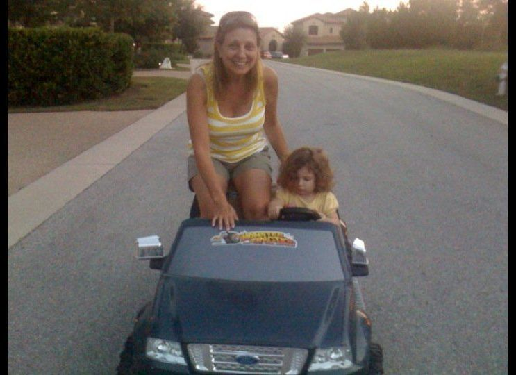 """We bought our grandchildren a battery-powered car. Abby got in and was frustrated that her feet could not reach the pedals."