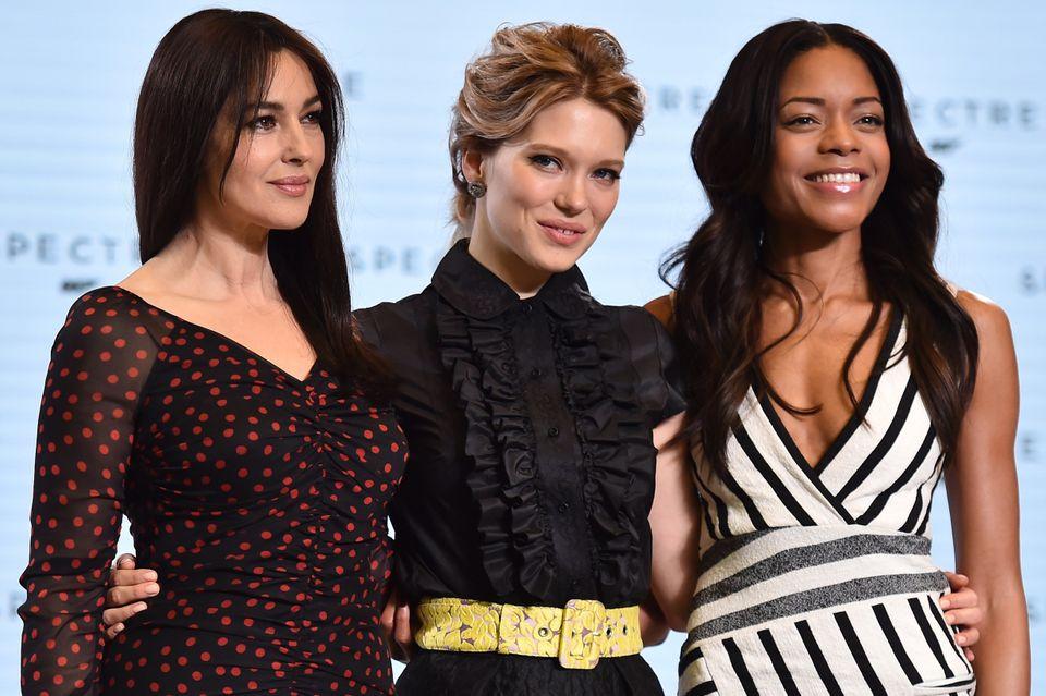 Italian actress Monica Bellucci (L), French actress Lea Seydoux (C) and British actress Naomi Harris (R) pose during an event