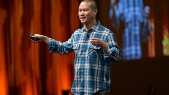 LAS VEGAS, NV - MARCH 27:  Zappos.com CEO Tony Hsieh speaks onstage at CinemaCon's final day luncheon and special presentation during CinemaCon, the official convention of the National Association of Theatre Owners, at Caesars Palace on March 27, 2014 in Las Vegas, Nevada.  (Photo by Charley Gallay/Getty Images for CinemaCon)