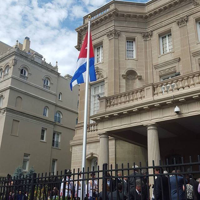 The Cuban flag is raised in front of the Cuban Embassy in Washington, D.C on July 20, 2015.