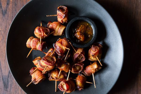 "<strong>Get the <a href=""http://food52.com/recipes/20525-the-elegant-hors-d-oeuvre-s-bacon-wrapped-water-chestnuts"" target=""_"