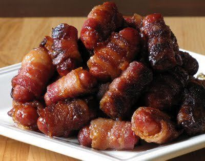 "<strong>Get the <a href=""http://cookingventures.blogspot.com/2009/09/bacon-wrapped-lil-smokies.html"">Bacon-Wrapped Li'l Smoki"