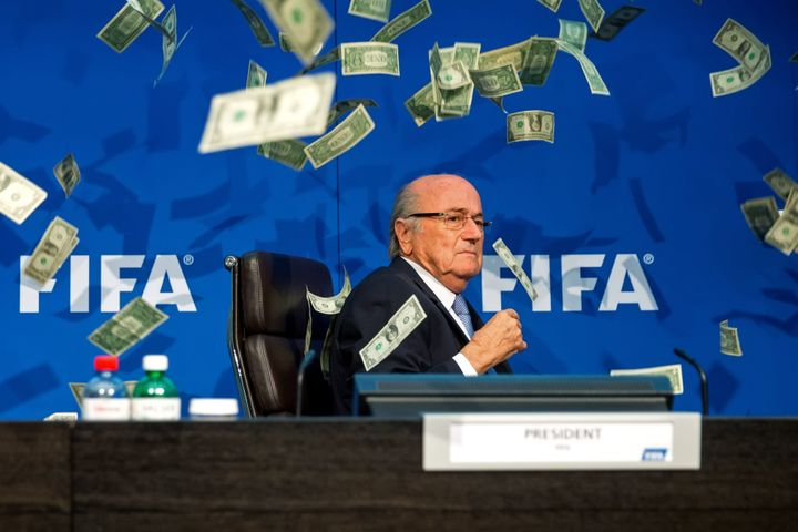 Sepp Blatter was showered with cash by a protester during a FIFA press conference in Zurich on Monday.