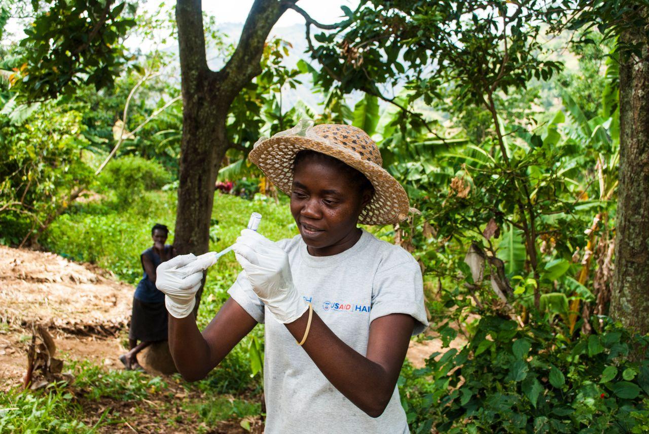<p>Ketia Orvilus, a community health agent, prepares a vaccine.</p>