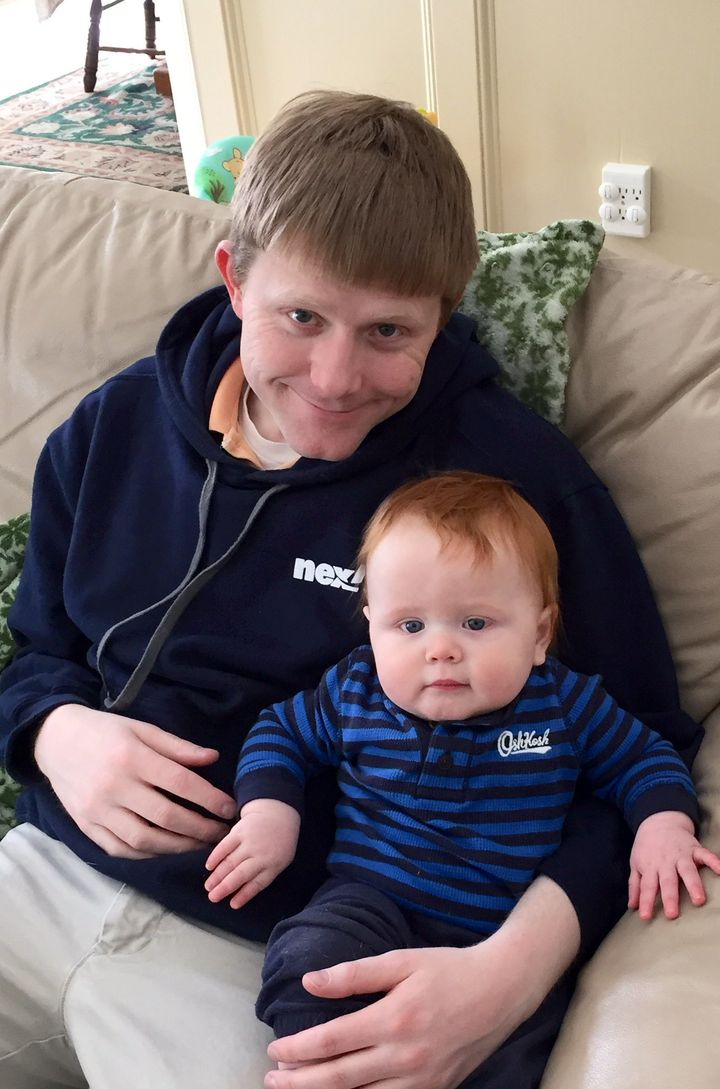 Troy Goode and his child in an undated photo.