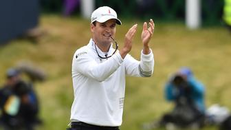 US golfer Zach Johnson reacts after winning the three-way playoff on the 18th green on day five of the 2015 British Open Golf Championship on The Old Course at St Andrews in Scotland, on July 20, 2015.US golfer Zach Johnson beat Australia's Marc Leishman and South Africa's Louis Oosthuizen in a four-hole playoff after finishing they had all finished on totals of 15-under par, 273. AFP PHOTO / BEN STANSALL        (Photo credit should read BEN STANSALL/AFP/Getty Images)