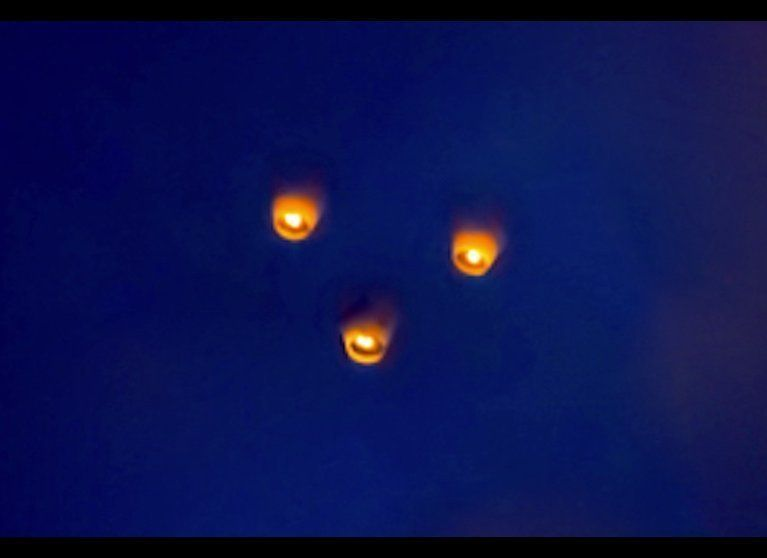 Chinese or sky lanterns are often misidentified as UFOs. These three were part of a large group of lanterns that was the main