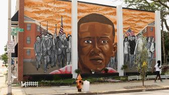 BALTIMORE, MD - JUNE 09:  A mural memorializing Baltimore resident Freddie 'Pepper' Gray is painted on the wall near the place where he was tackled and arrested by police at the Gilmor Homes housing project June 9, 2015 in Baltimore, Maryland. In the wake of protests, demonstrations and riots triggered by the April 19 death of Gray, officials said the city experienced 43 murders last month, its deadliest May since 1970. People who live in Gray's neighborhood say one of the reasons for the spike in shootings is because police have dramatically increased response time, creating an atmosphere of lawlessness in some of Baltimore's most crime-affected areas.  (Photo by Chip Somodevilla/Getty Images)
