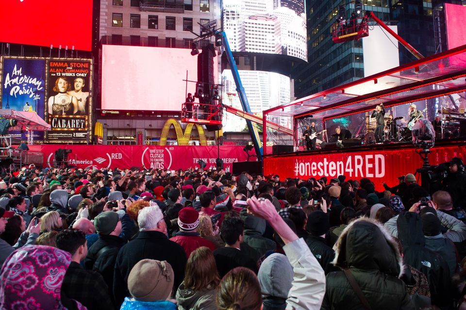 Bruce Springsteen and U2 perform during the World AIDS Day (RED) concert In Times Square on Monday, Dec. 1, 2014 in New York.