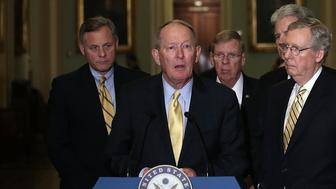 WASHINGTON, DC - JUNE 04:  U.S. Sen. Lamar Alexander (R-TN) (2nd L) speaks to members of the media as (L-R) Sen. Richard Burr (R-NC), Sen. Johnny Isakson (R-GA), Sen. Tom Coburn (R-OK), and Senate Minority Leader Sen. Mitch McConnell (R-KY) listen June 4, 2013 on Capitol Hill in Washington, DC. The Senate Republicans had their weekly policy luncheon to discuss the Republican agenda.  (Photo by Alex Wong/Getty Images)