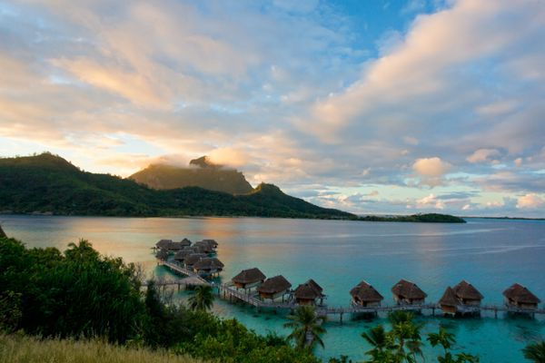 """Reader Mona G. Low would love to stay in """"one of those thatched huts over the turquoise ocean."""""""