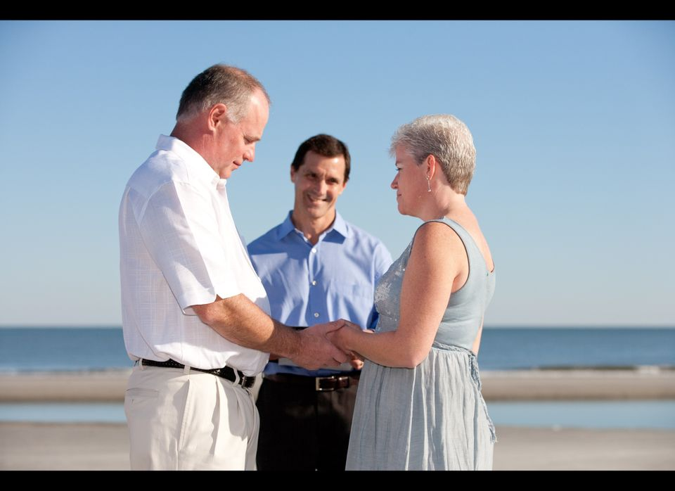 "David and Trish Palmer say ""I do"" on a beach in Hilton Head, South Carolina. One of Trish's co-workers, Mike Hinkes, married"