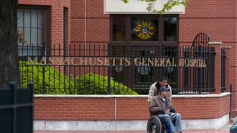 BOSTON - MAY 20:  A man is pushed in a wheelchair outside Massachusetts General Hospital where US Sen. Edward Kennedy (D-MA) is being treated May 20, 2008 in Boston, Massachusetts. After being taken to the Massachusetts hospital on Saturday for a seizure, Kennedy, 76, has been diagnosed with a malignant tumor in the left parietal lobe of the brain.  (Photo by Jodi Hilton/Getty Images)