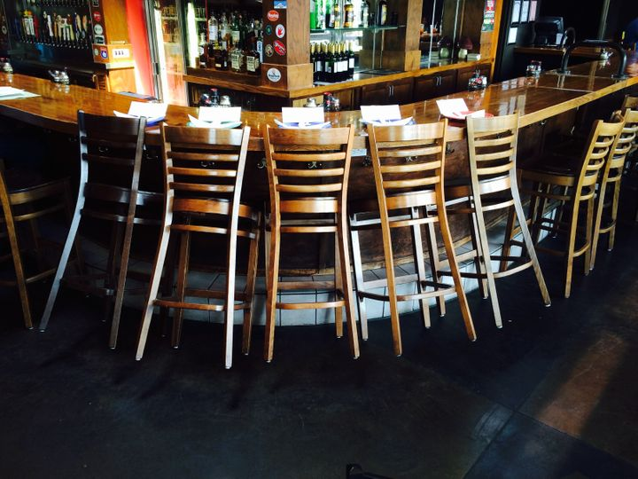 Bar stools were set aside at the downtown Chattanooga Mellow Mushroom location for those who died after the shooting.
