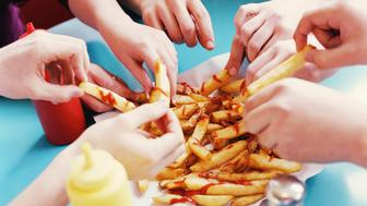 Hands Taking French Fries