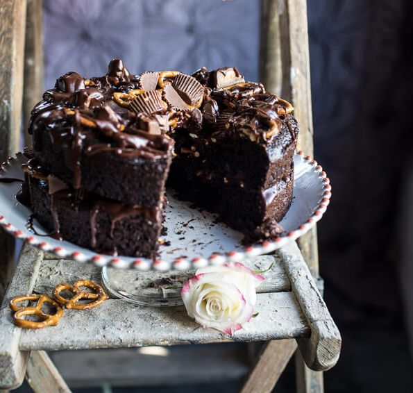 """<strong>Get the <a href=""""http://www.halfbakedharvest.com/fudgy-one-bowl-chocolate-peanut-butter-cup-pretzel-cake/"""" target=""""_b"""