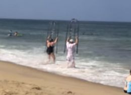 North Carolina Couple Uses Homemade Shark Cages When Going Into Ocean