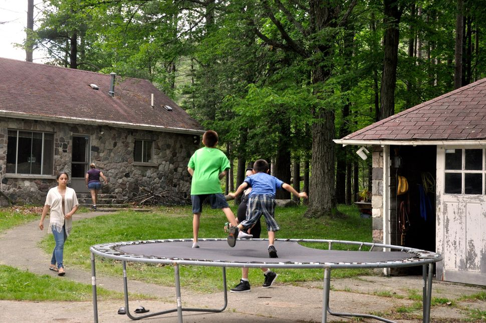 Two kids bounce on the trampoline at David Salha's property in Lupton, Michigan.