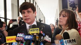 CHICAGO, IL - JUNE 27:  Former Illinois Governor Rod Blagojevich speaks to the media with his wife Patti following a guilty verdict in his corruption retrial at the Dirksen Federal Courthouse June 27, 2011 in Chicago, Illinois. After deliberating for nine days jurors found Blagojevich guilty of 17 out of the 20 counts that he was being retried on including trying to sell an appointment to President Barack Obama's vacated U.S. Senate seat.  (Photo by Tasos Katopodis/Getty Images)