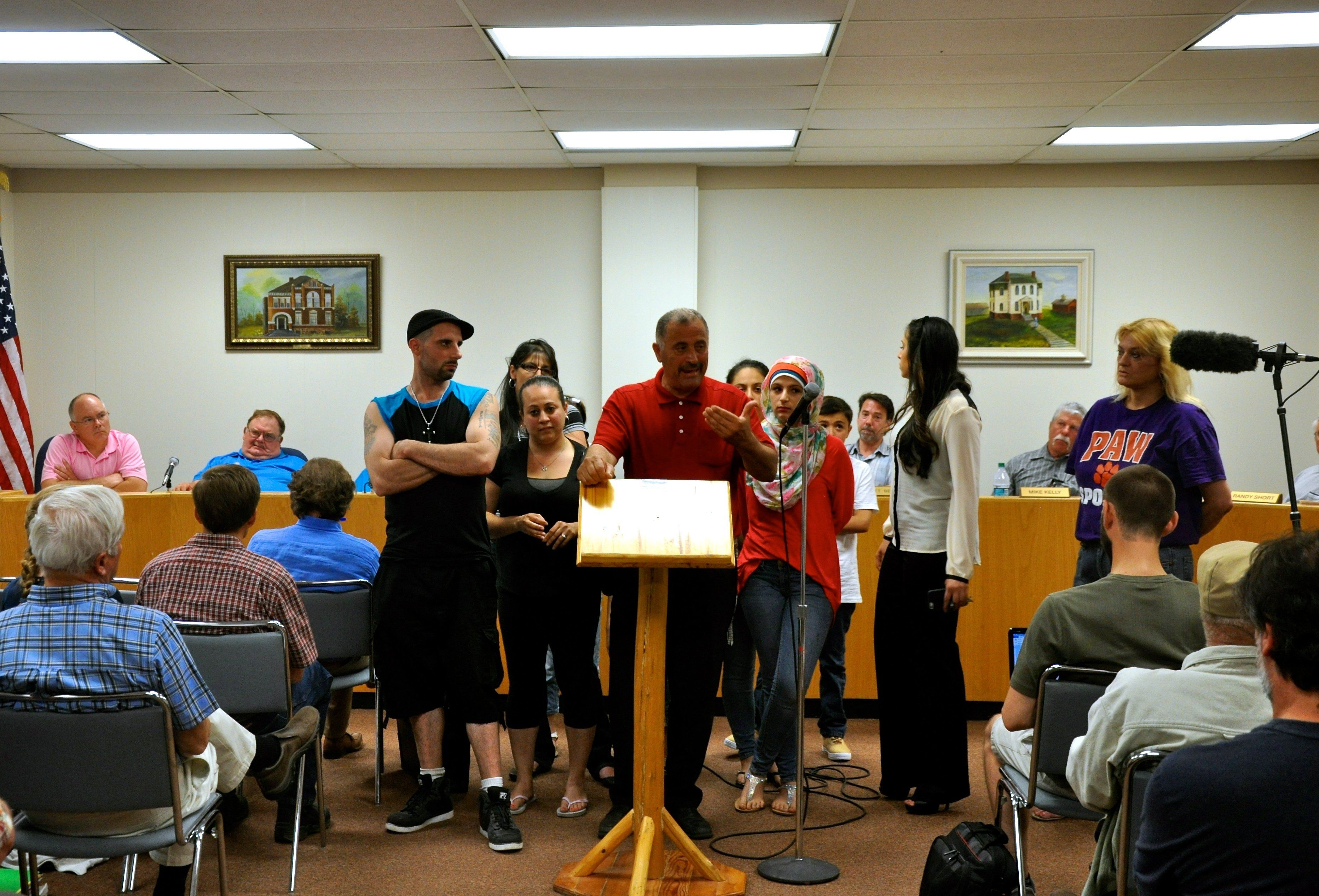 David Salha stands with his family and addresses concerns over his plan to build a summer youth camp on his property at the O