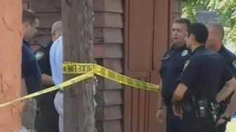 Authorities outside the residence where the man was shot on Saturday.