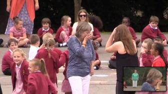 Retiring teacher surprised with flash mob on her last day of school.