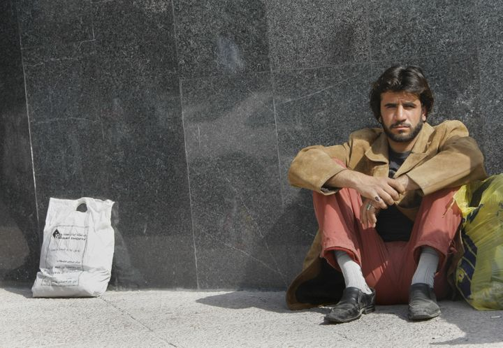 <span>An Iranian temporary manual worker waits for work in Tehran on March 11, 2008.&nbsp;</span>