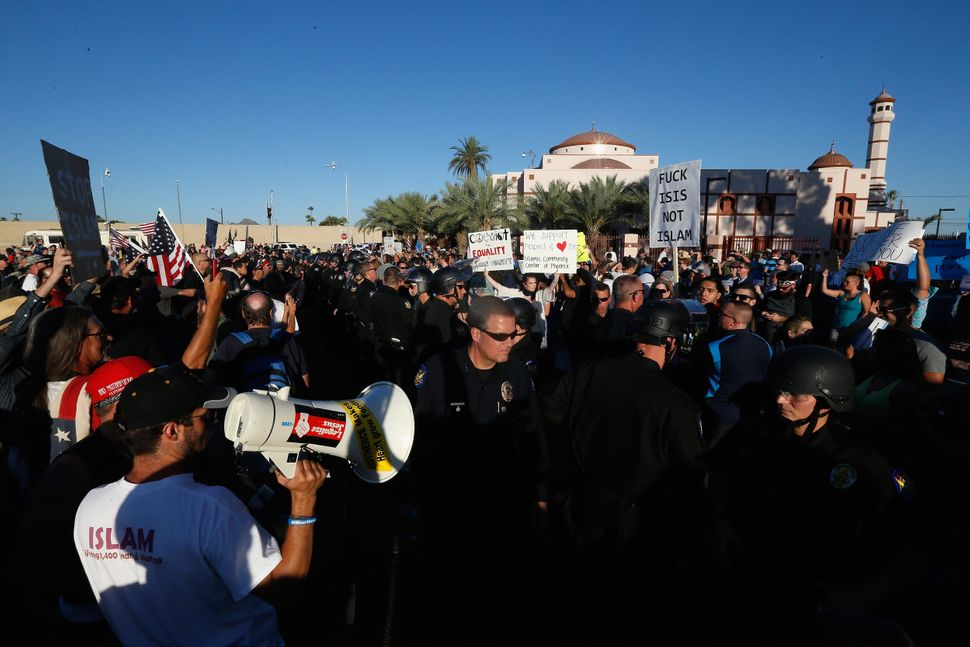 Protesters and counter-protesters rally outside the Islamic Community Center on May 29, 2015 in Phoenix, Arizona. Crowds gath