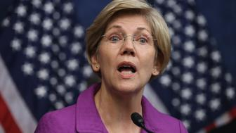 WASHINGTON, DC - JULY 21:  Sen. Elizabeth Warren (D-MA) delivers remarks during a news conference on the fifth anniversary of the Dodd-Frank Wall Street Reform and Consumer Protection Act at the U.S. Capitol Visitors Center July 21, 2015 in Washington, DC. Before being elected to the U.S. Senate, Warren helped craft the legislation that created the Consumer Financial Protection Bureau which has helped return $10 billion to 17 million consumers since it was created in 2011. (Photo by Chip Somodevilla/Getty Images)