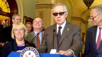 Senate Democratic leaders are bemused by a reporter asking Minority Leader Harry Reid if it is befitting for Donald Trump to give out Sen. Lindsey Graham's cell phone.