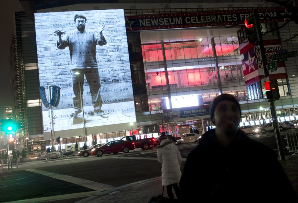 An art projection by Chinese artist and activist Ai Weiwei appears on the 74-foot marble First Amendment tablet on the exteri