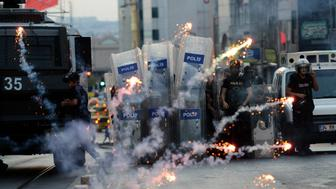 Turkish riot police use rubber bullets to disperse protesters as protestors fire fireworks at Kadikoy district in Istanbul on July 21, 2015, a day after a suicide bomb attack blamed on the Islamic State killed 32 people in the southern Turkish town of Suruc. Turkish police today fired tear gas and water cannon against hundreds of protesters who took to streets to condemn the deadly suicide attack in a border town, an AFP photographer reported.  AFP PHOTO /OZAN KOSE        (Photo credit should read OZAN KOSE/AFP/Getty Images)