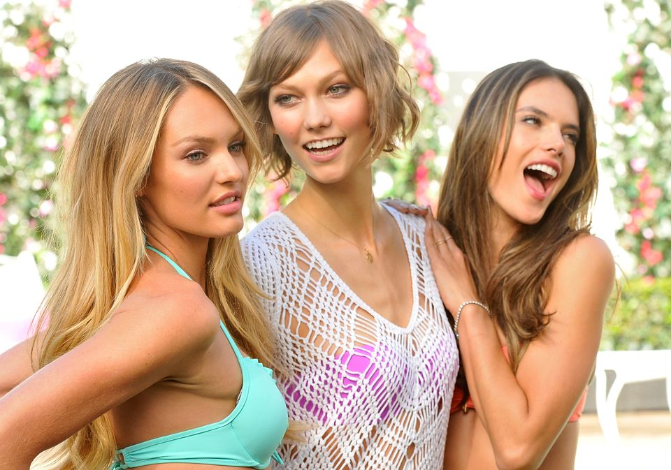 From left to right, models, Candice Swanepoel, Karlie Kloss and Alessandra Ambrosio pose together at the reveal of Victoria's