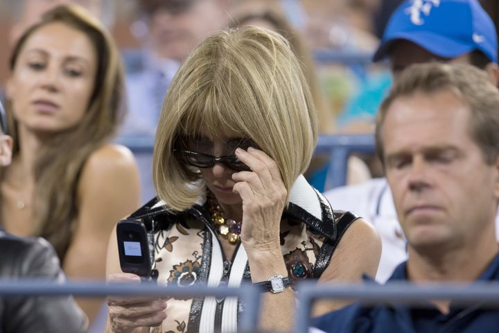 Anna Wintour on her flip phone at the U.S. Open last year.