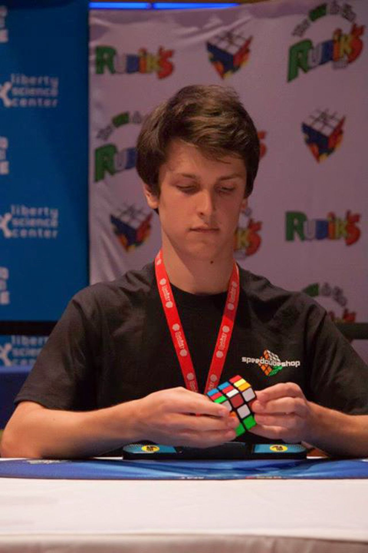 Feliks Zemdegs solves a three-by-three cube.