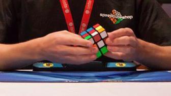 <p>Feliks Zemdegs solves a three-by-three cube.</p>