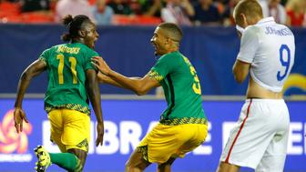 ATLANTA, GA - JULY 22:   Darren Mattocks #11 of Jamaica celebrates scoring the opening goal against the United States of America with Michael Hector #3 during the 2015 CONCACAF Golf Cup Semifinal match between Jamaica and the United States at Georgia Dome on July 22, 2015 in Atlanta, Georgia.  (Photo by Kevin C. Cox/Getty Images)